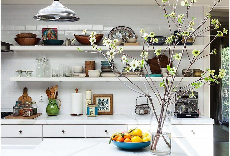 All-white open shelving fades into the background, leaving your focus on an eclectic serveware.