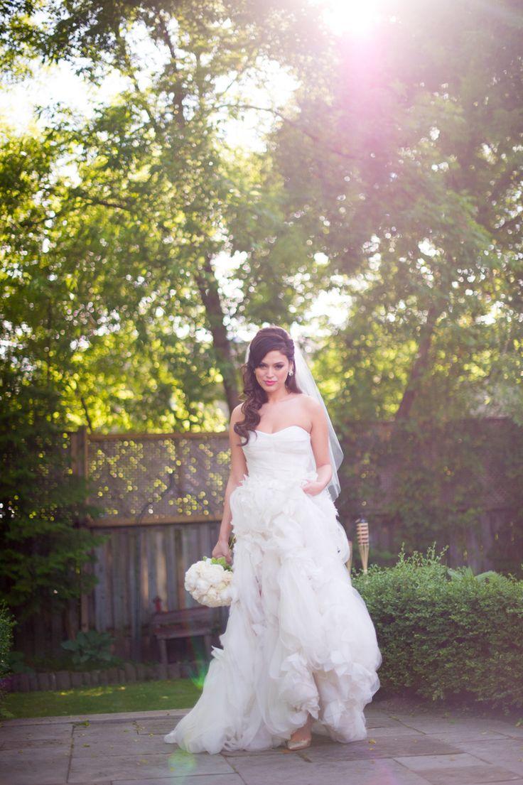bride wearing gorgeous Monique Lhuillier wedding dress