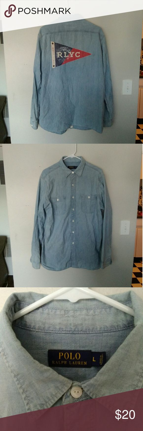 Polo Ralph Lauren flag shirt Polo Ralph Lauren button down light denim shirt with the yacht club flag on the back. Men's size Large and fits true to size. Polo by Ralph Lauren Shirts Polos