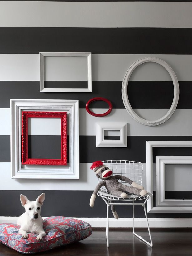 "Empty Picture-Frame Wall Grouping : Rooms : Home & Garden Television Love this....I have this same kinda thing n the ""GRAND"" (grandkids rm) room with cocoa wall color and empty lime green, turquoise, choc brown frames. Like the stripes---might add 1 or 2 of those."