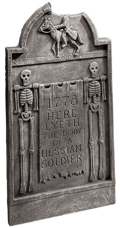 "Based on The Legend of Sleepy Hollow, this cleverly depicted tombstone marks the grave of the Hessian soldier who would become the Headless Horseman. Notice the perfectly placed ""missing"" piece."