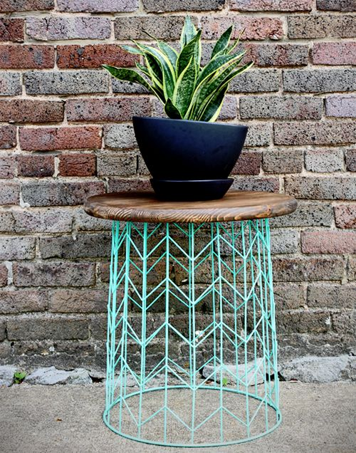 Spray Paint a Trash Can    Did you know that an old wire trash can has new possibilities? With spray paint and your imagination, it sure does. Its now an end table!