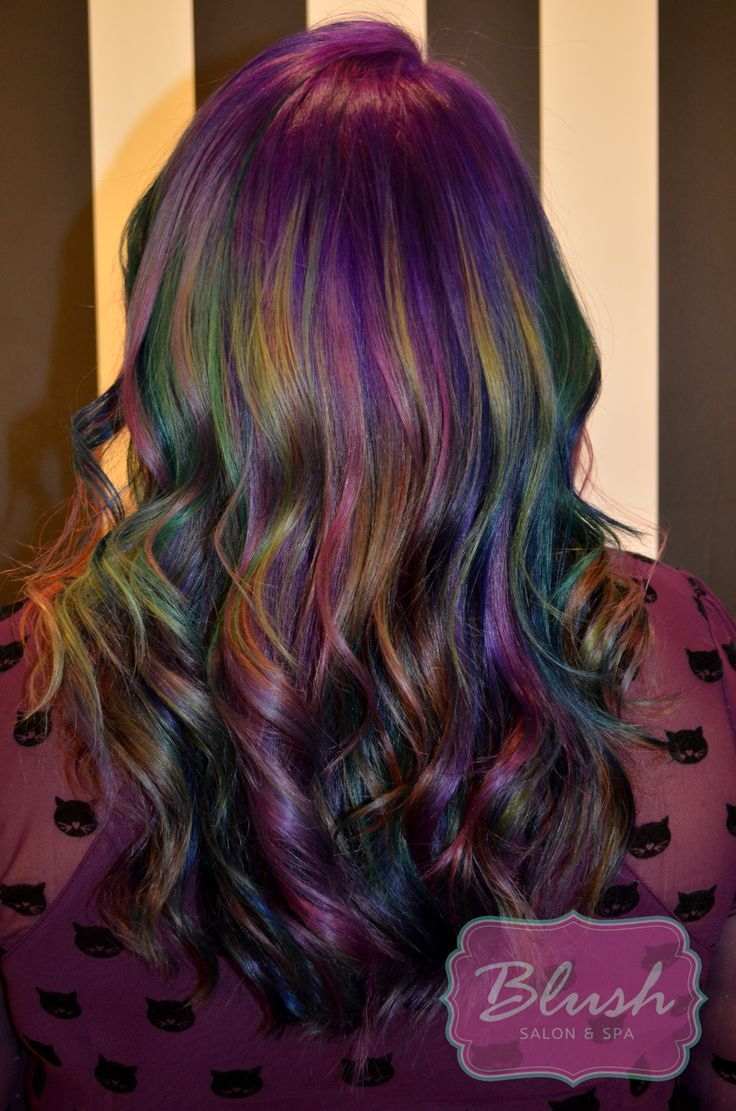 "We've noticed a new trend among stylists, Oil slick hair! Most artists find inspiration in everyday things. Its not surprising to try to mimic a blackened rainbow iridescent hue! At Blush we dive in any chance we can to try something fun , and I think we nailed it! You can do variations of ""Oil …"