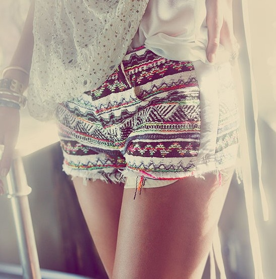 Boho lovin' -- colorful geometric pattern on kaki cutoff shorts.