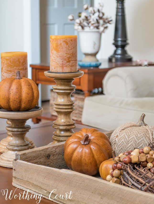 A supper easy fall coffee table vignette using an old planter's tray, candlesticks, a strand of diy wood beads and a few pumpkins || Worthing Court