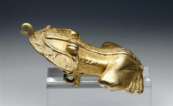"""A depletion gilded tumbaga frog [Panama] [Ca 500 to 1000 CE]. [ 2-3/4""""L x 2""""W. 91.1 grams] Private Collection"""