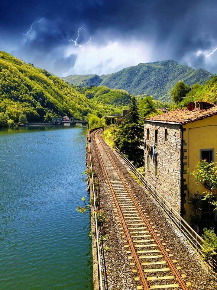 Railway by Serchio river. Comune di Borgo a Mozzano. Lucca, Tuscany, Italy.