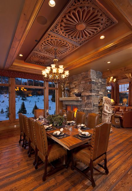 Beautiful Montana dining room has gorgeous carved wood ceiling medallions in a trayed ceiling.