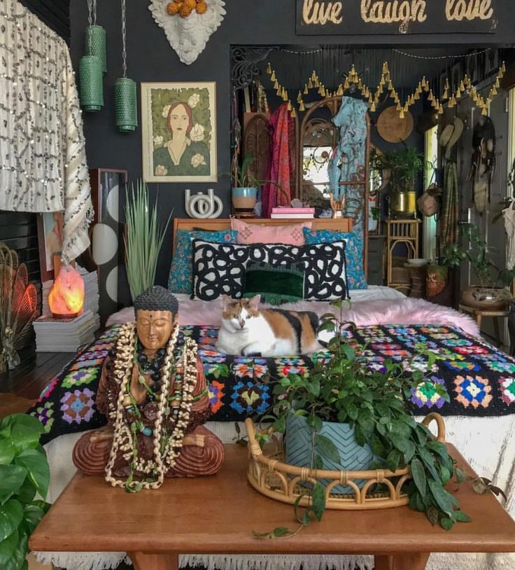 A DARK BOHEMIAN bedroom. Lots of colors, patterns & textures. Lots of knickknacks & plants. Wicker furnishings – use of natural materials is one of st…