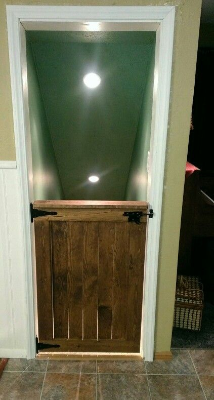 The barn style dutch door my hubby built from scratch for our basement stairway. He did amazing! Micoleys picks for #Basement www.Micoley.com