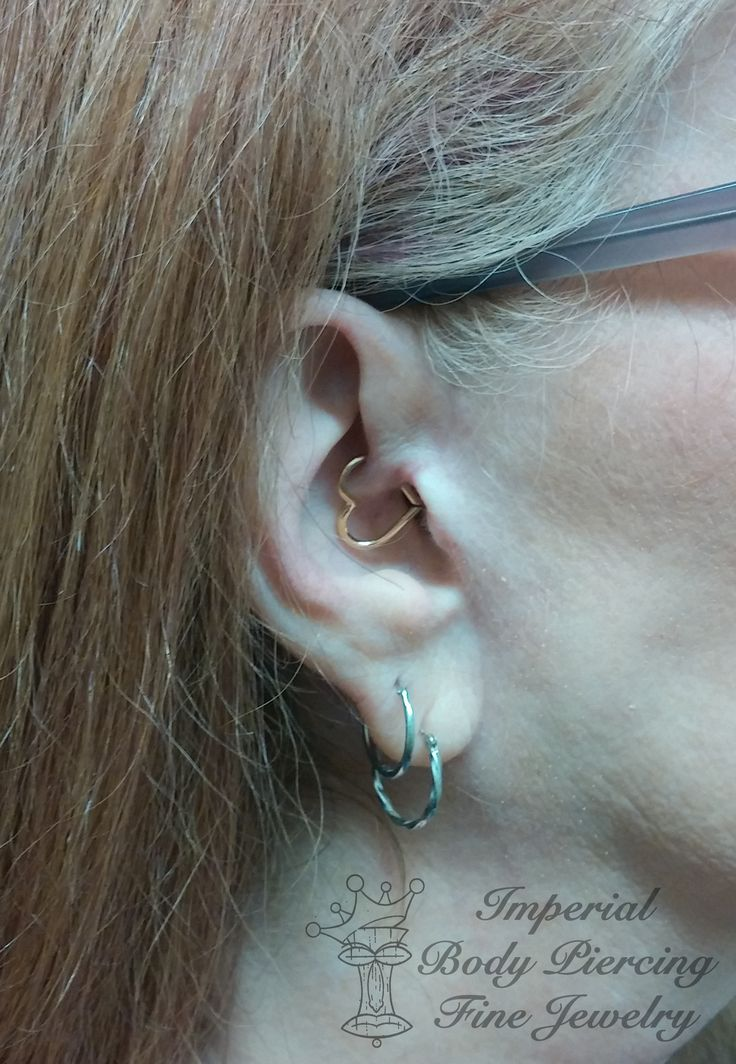 Daith piercing with a beautiful 14k Yellow Gold Heart by Phoenix Revival Jewelry. #daith #piercing #gold #heart #imperial #imperialbodyart #imperialtattoo #meridian #boise #idaho