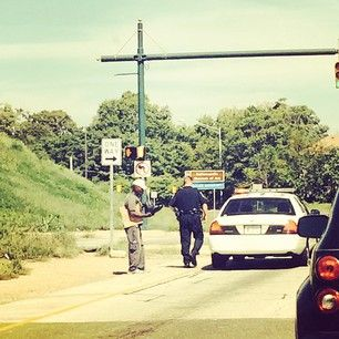 Indiana Pacers center Roy Hibbert was driving home from the gym Monday when an Indianapolis police officer flashed his lights and pulled over. | NBA Player Captures Police Officer's Generosity Toward Homeless Man
