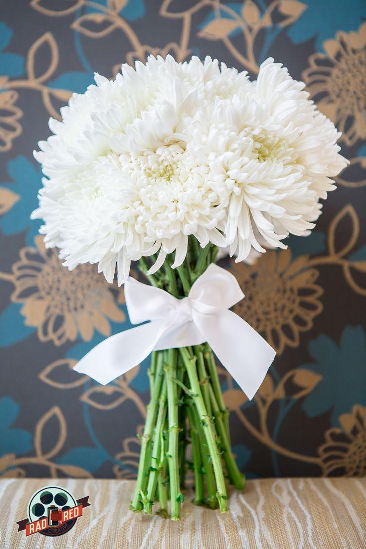 Stunning Spider Mums Bouquet! Simple but classy!   Photo by Rad Red Creative www.radredcreative.com #makeyourweddingrad #weddingphotography #bouquet #redbouquet #tampaphotography #tampaweddingphotography #tampawedding #tampaphoto #bouquet #weddingbouquet #spidermums #spidermumbouquet