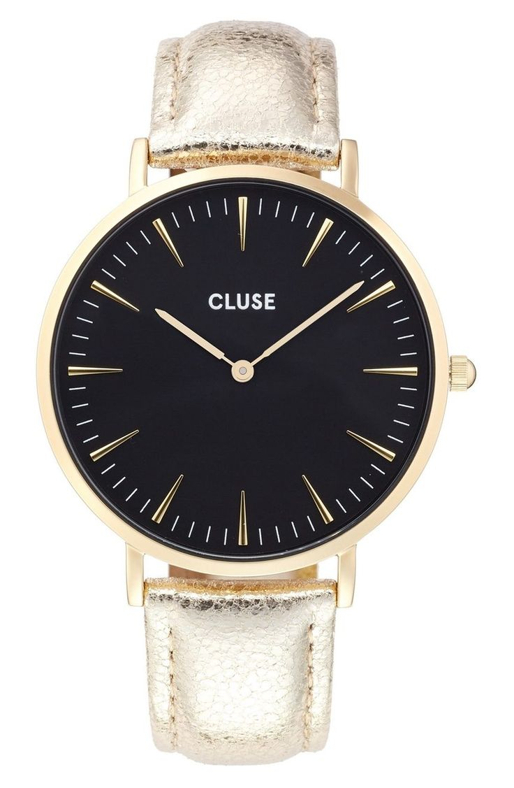 It's true that not all that glitters is gold—sometimes it's leather. Like this crackled metallic band anchoring the elegantly simple round watch with sharp hour markers. Dazzling, yet understated.