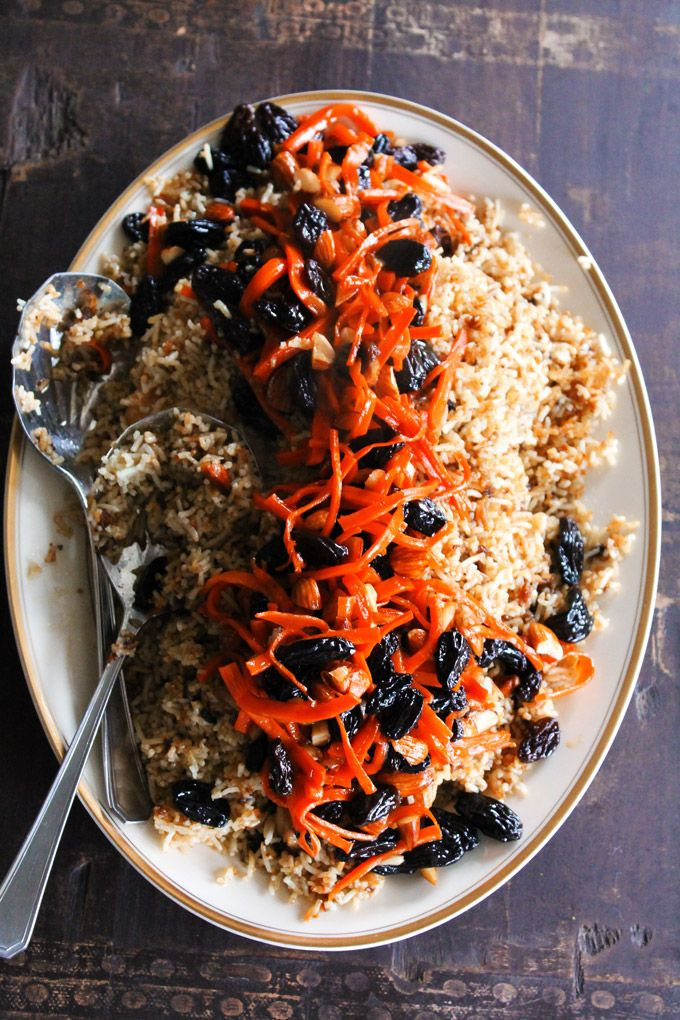 This wonderful Kabuli Palau is Afghanistan's National dish! Rich chicken and rice with sweet and cruncy carrots, raisins, and almonds. Get the recipe!