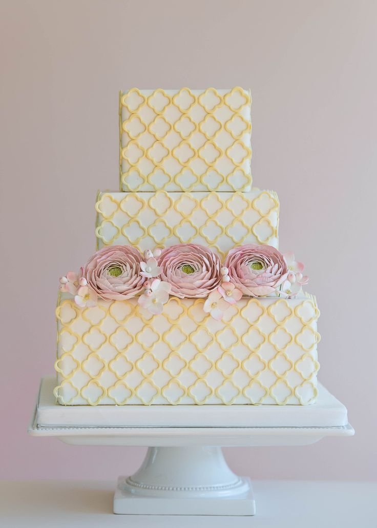 Square Wedding Cakes - Quatrefoil cutouts with sugar ranunculus and hydrangea by Ericaobriencakes