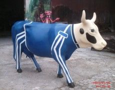 Racer Cow Statue