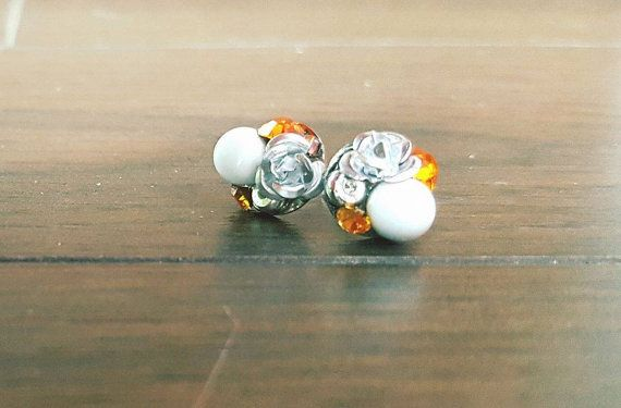 Loop set with a silver rose, Orange two stones of the Rhine Swarovski, a cue ball and a silver washer. BEAUTIFUL loop that offers lots of textures.