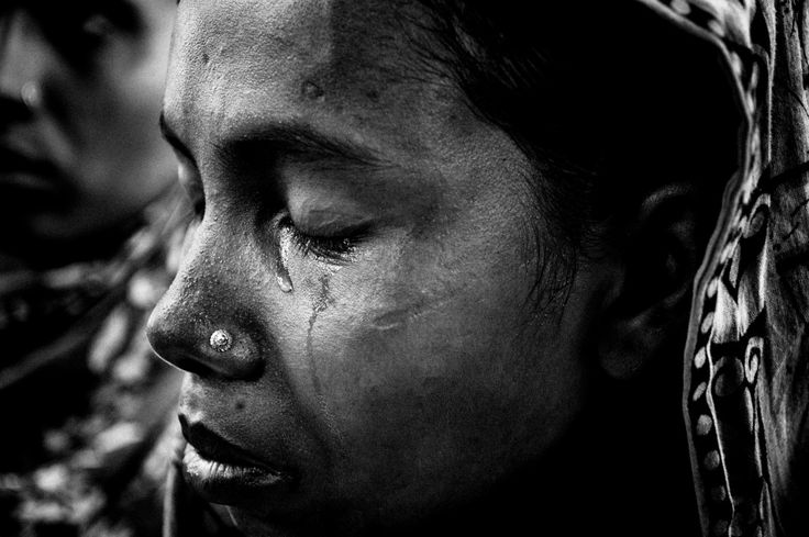 2014, Spot News, 3rd prize stories, Rahul Talukder, Bangladesh COLLAPSE OF RANA PLAZA A woman grieves for a missing family member who used to work in one of the garment factories of Rana Plaza.