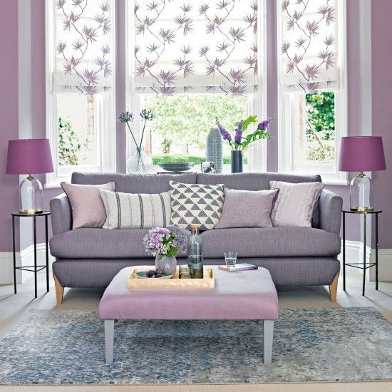 Lilac living room with grey-toned sofa and floral blinds