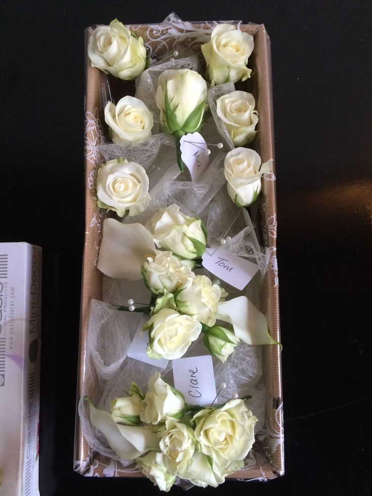 Ivory rose button holes and corsages