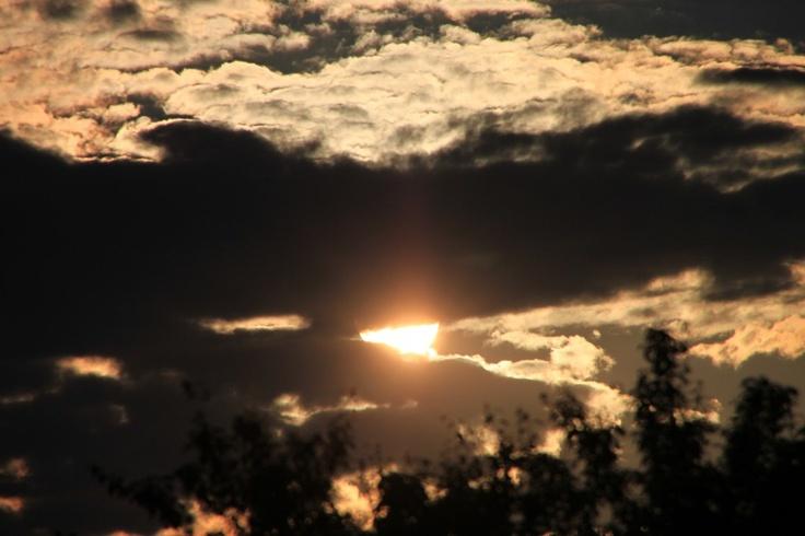 Sun under Dark Clouds at Sunset