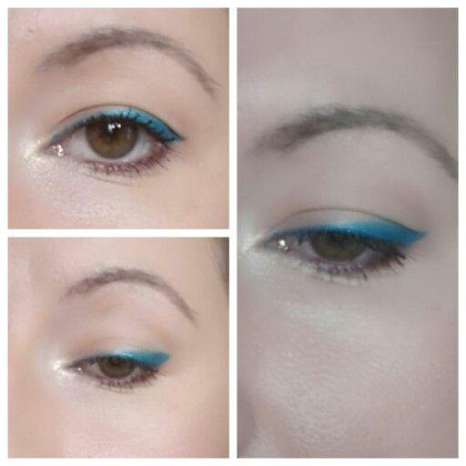 Turqoise eyeliner and purple lash line