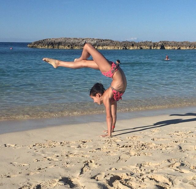 Annie the Gymnast! Instagram @presshandstands #GymnasticOnTheBeach