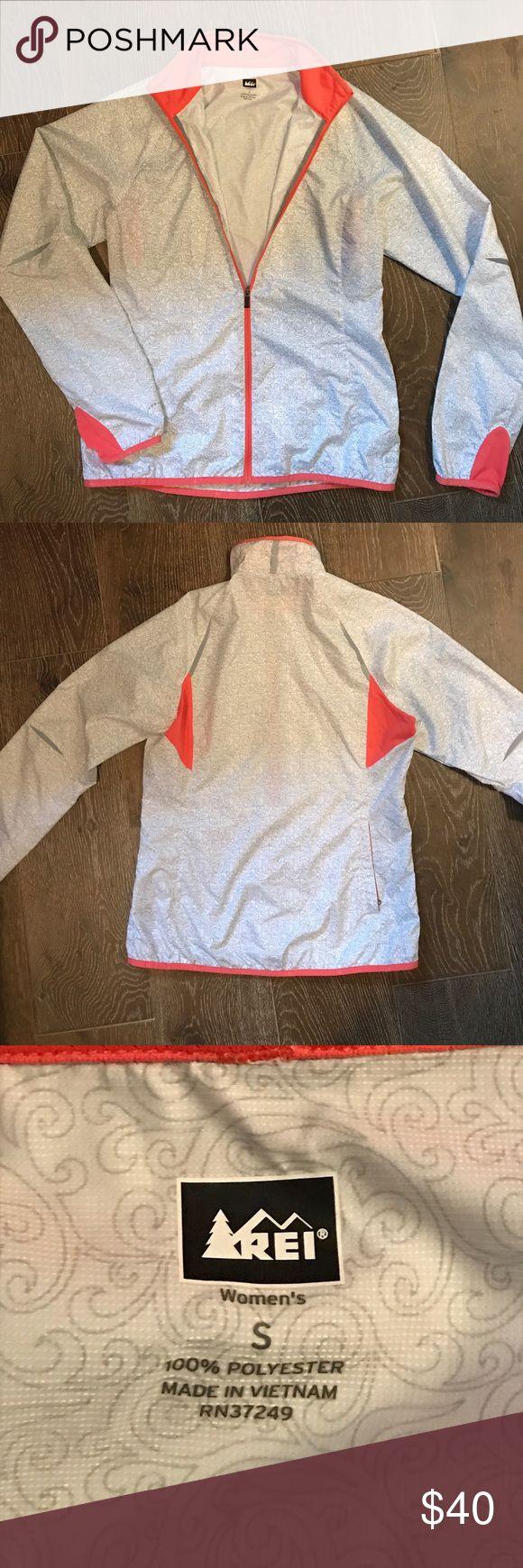 REI lightweight rain jacket size small Lightweight zip up rain jacket. Has reflective details. Zipper pocket for smart phone with a hole to thread the headphones through REI Jackets & Coats
