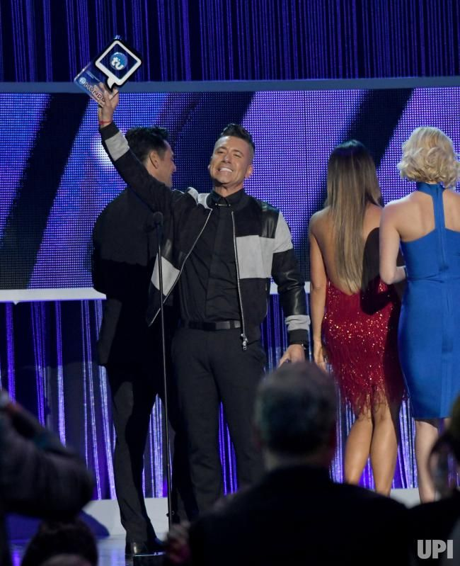 Jorge Bernal accepts an award at the 2017 Telemundo Premios Tu Mundo show at the American Airlines Arena in Miami, Florida, August 24,…