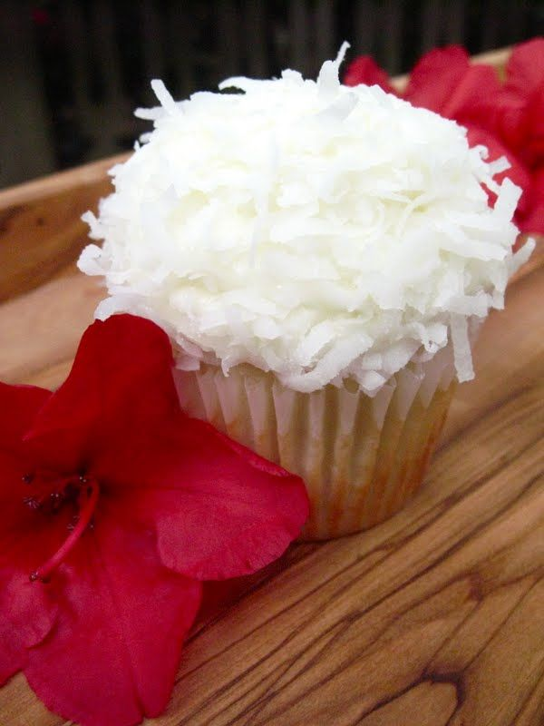 It has been my quest, for a good 12 years now, to find the perfect coconut cupcake recipe.  This looks promising.