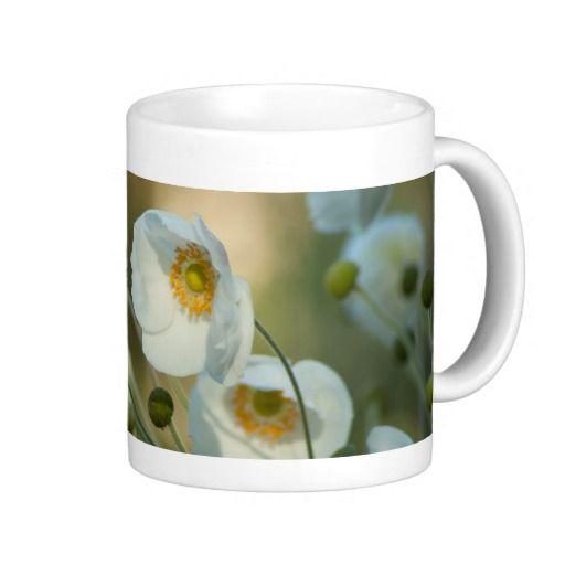 white windflowers in a natural display coffee mug