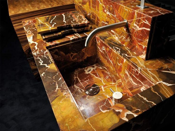 @mgsmilano has custom design on tap. This sleek custom faucet beautifully contrasts the marble's rich, natural veining.