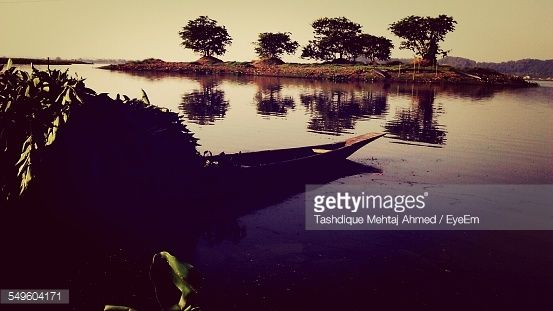 Stock Photo : View Of Wooden Canoe On Tranquil Lake
