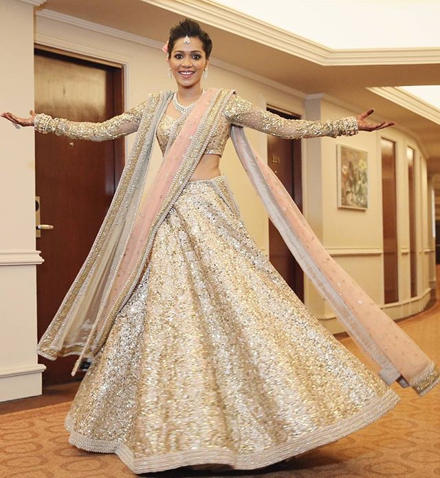 Dazzle in a shimmering ensemble like Varsha's gold and pale pink sequinned…