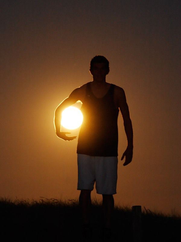 There's a whole collection of these forced perspective photos using the sun and the moon - this one is my favorite!