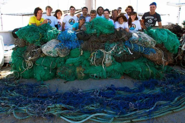 Ocean Cleanup crew with monster ghost net