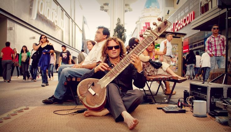 In Chile they listen to Folkoric, classical, indain.   The most liked or known is Central Folk.  In the picture it is an Indian instrument.