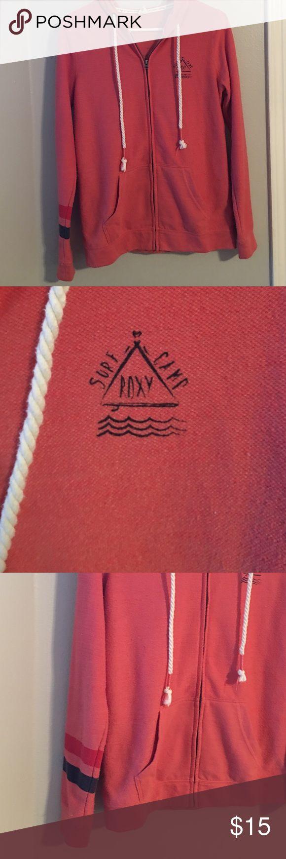 Roxy zip up hoodie Red orange zip up Roxy Surf Camp hoodie.  Red and blue stripe on right arm.  Gently worn,  good condition. Roxy Tops Sweatshirts & Hoodies