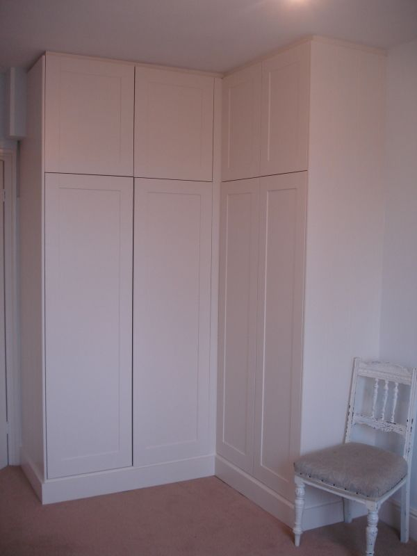 Simple corner wardrobe (same paint color as the current wall)