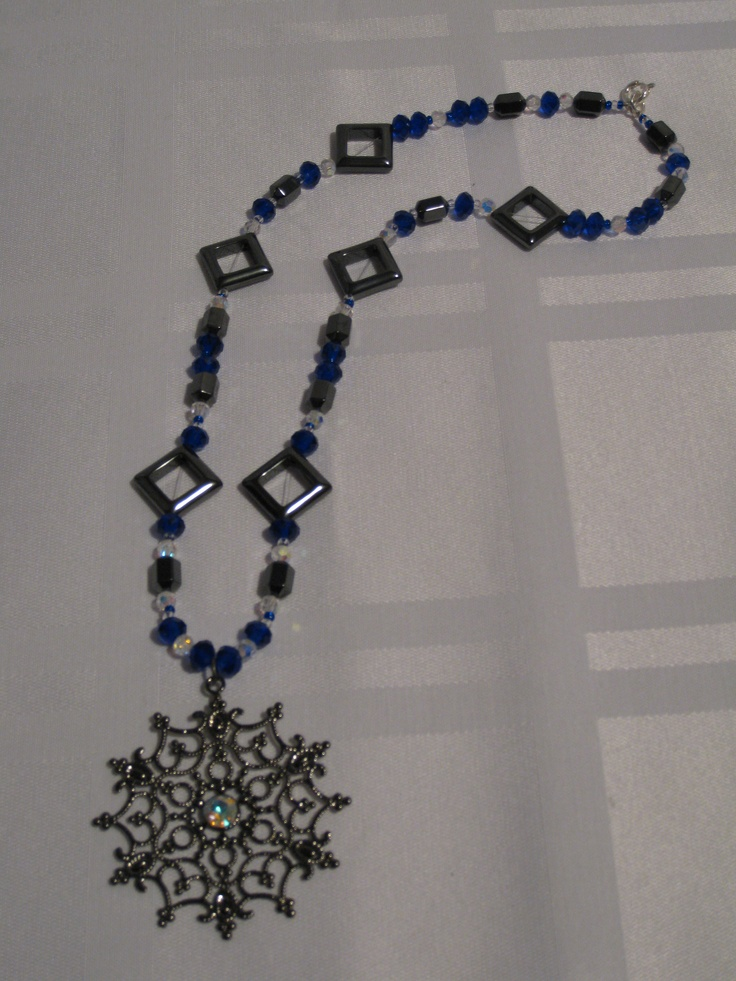 Snowflake inspired pendant with blue, silver and white chinese crystals with hematite beads