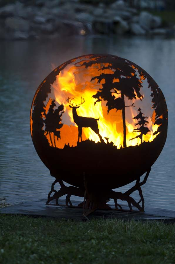 Up North Fire Pit. Round Sphere with family of deer, doe, fawn, buck, Bull Moose, ducks, inspired by the north woods of Minnesota. wood burning firepit.