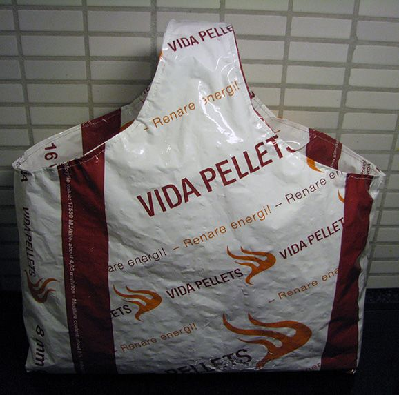 Reusing plastic sacks that contained wooden pellets.