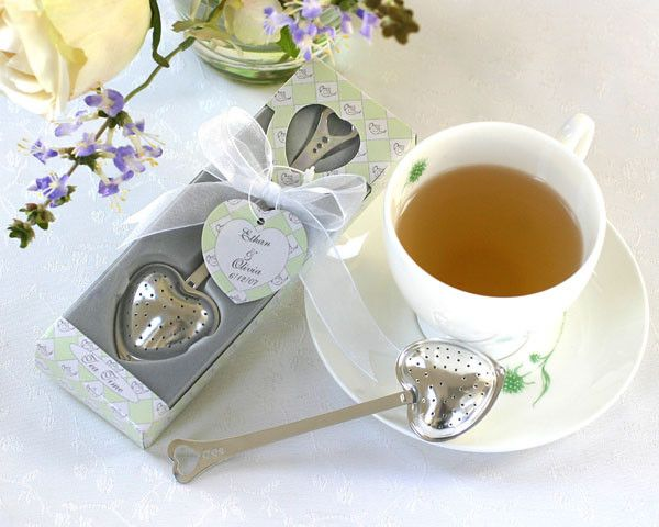 Time for you, time for me, time for fun, time for tea! This elegant tea infuser brings sophistication to any affair. A delicate heart theme distinguishes the infuser, and makes it a lovely favor for w