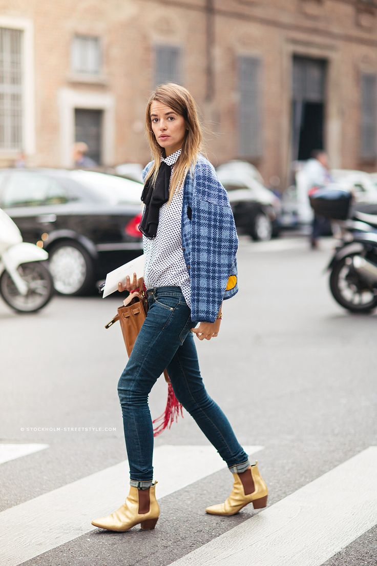 Carlotta Oddi in plaid blazer and gold booties: