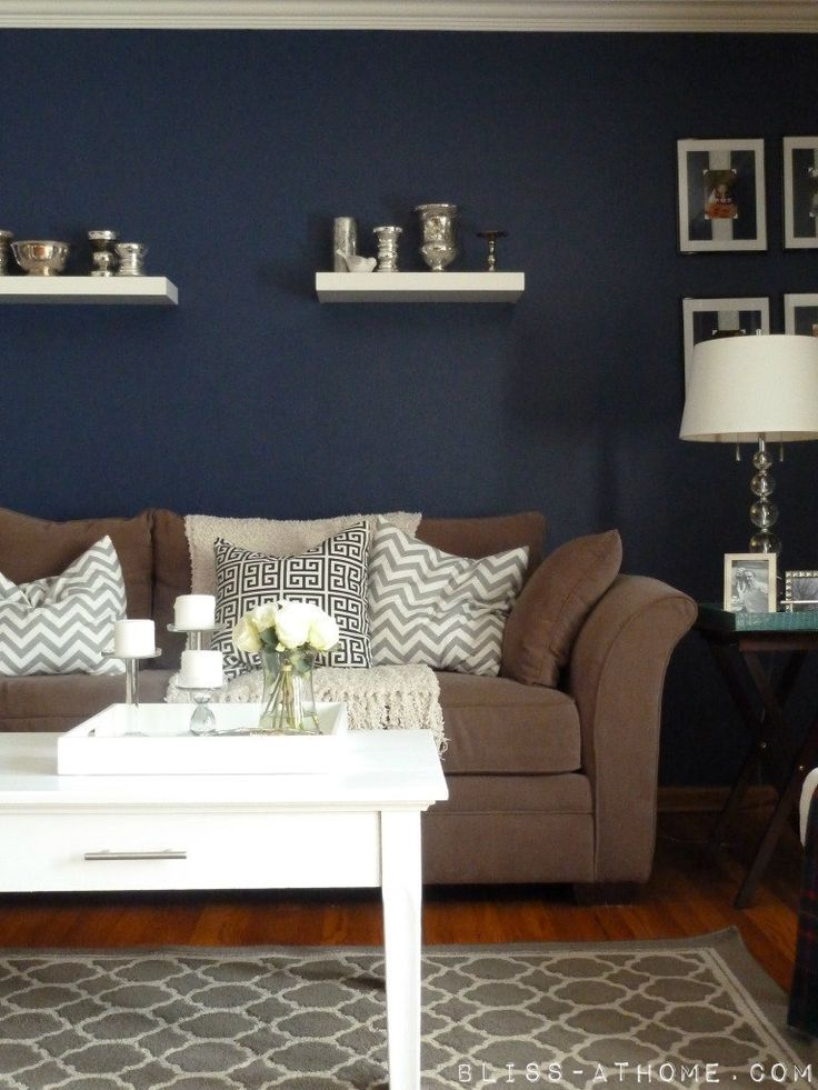 White Frames And White Shelving On Dark Wall Brown Living Room Decor Brown And Blue Living Room Blue Living Room