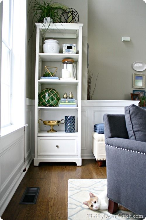 Using a white #etagere to make a room more functional #organization (I need one of these in every room!)
