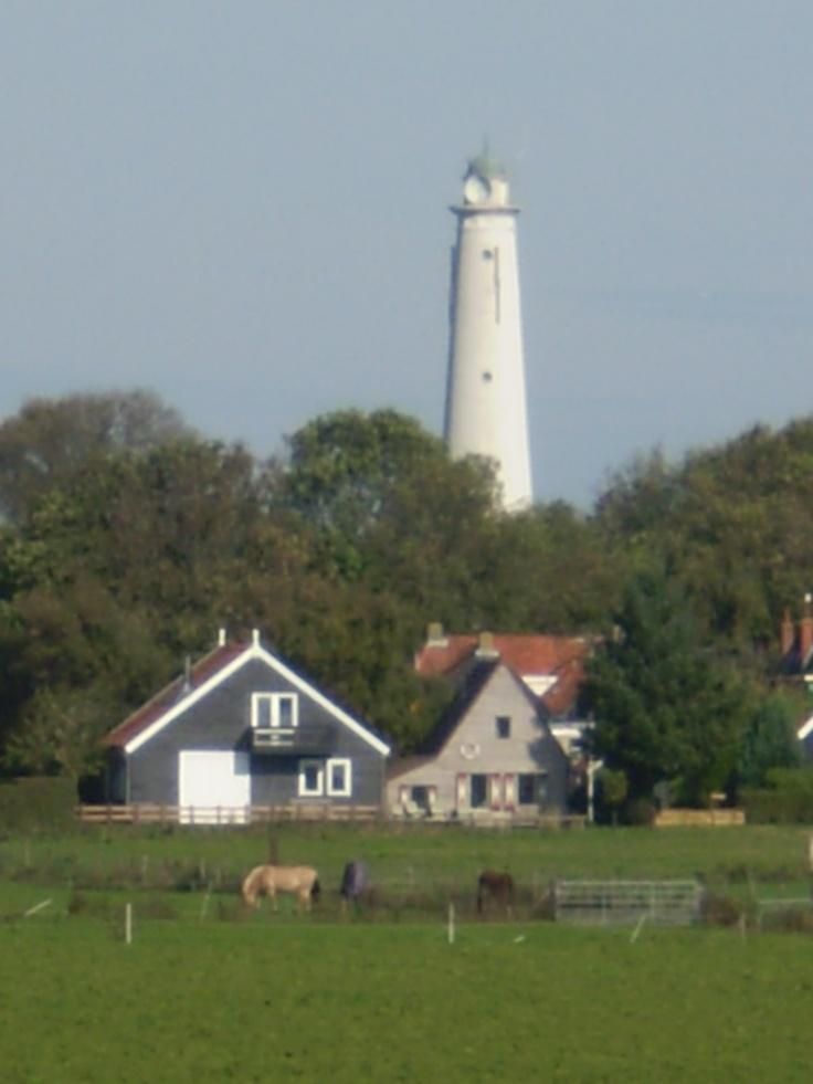 Lighthouse, Schiermonnikoog, The Netherlands. De Zuidertoren werd in 1854, tegelijk met de huidige vuurtoren gebouwd. Men had vroeger geen lichtkarakters en plaatste men soms twee torens of vuren, zodat de zeeman wist waar hij was. Twee vuren of torens vormden een lijn, zodat schepen langs gevaarlijke ondiepten konden varen. In 1910 kreeg de buitentoren, de huidige vuurtoren, een draailicht en was het licht van deze toren overbodig. Watertoren 1950-1992. Tegenwoordig is het een antennetoren.