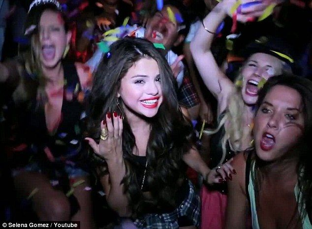 Party time: In the clip, Selena Gomez is seen enjoying a house party with friends
