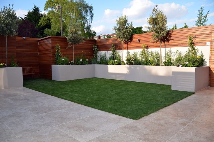 Privacy screen hardwood fake grass raised bed white planting travertine London Chelsea Wandsworth Fulham Kensington